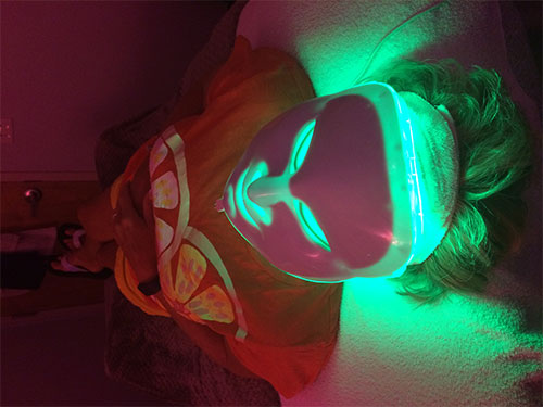 Client enjoying LED Light Therapy following her Rezenerate Treatment